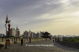 Walkers on the Xi'an City Wall at sunset, China