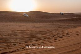 Sun setting during desert safari on the sand dunes outside Dubai, UAE