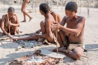 Woman form Bushmen tribe making jewellery, Namibia