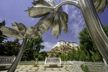 Flower sculptures with view of Potala Palace in Lhasa, Tibet, China