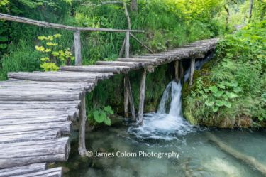 Waterfall under the walkway at Plitvice Lakes National Park, Croatia