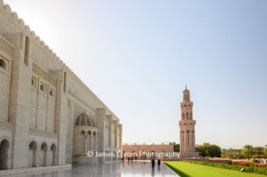 Exterior view with morning sun at Sultan Qaboos Grand Mosqure, Muscat, Oman