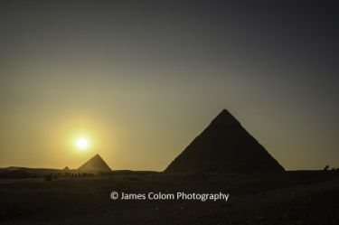 Sunset over the Great Pyramid of Khufu at Giza, Cairo, Egypt