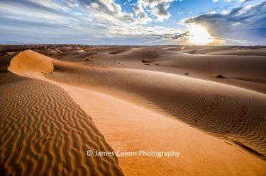 Sunset over Al Wasil sand dunes, Oman