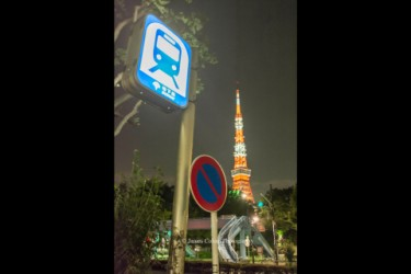 Tokyo Tower with subway sign in foreground