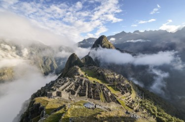 Machu Picchu with parting fog at sunrise, Peru