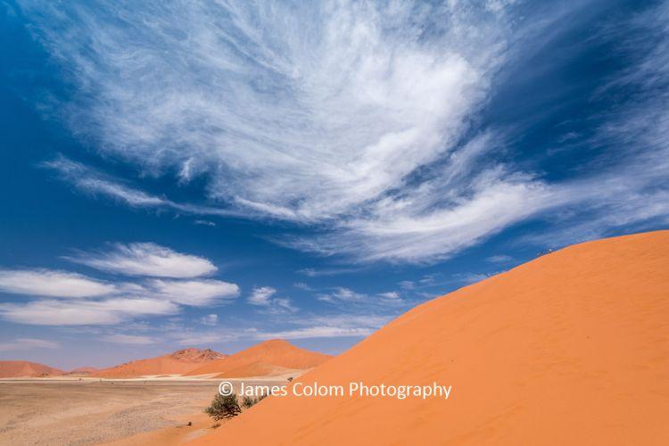 People climbing Dune 45 at Sossussvlei, Namibia