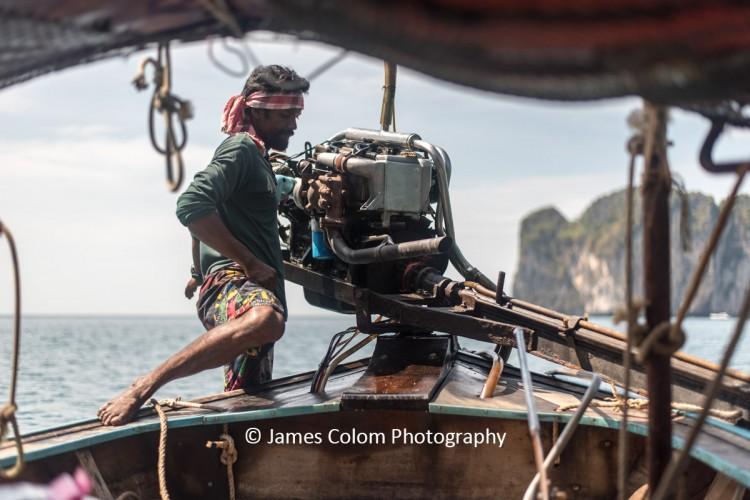 Fisherman guiding his speedboat near Krabi, Thailand