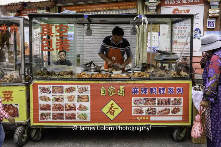 Meat trader at the street market in Lhasa, Tibet, China
