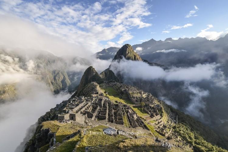 Machu Picchu with parting fog at sunrise, Peru